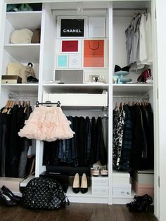 Chic closet design with pull out shelves and vanity area.