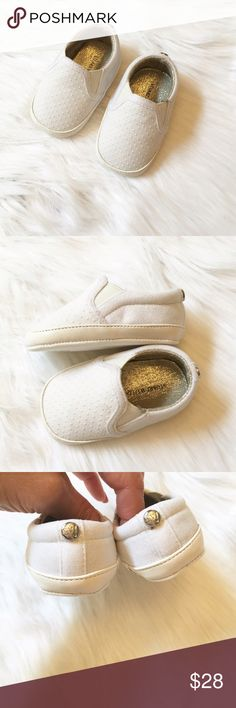 Baby Girl Stuart Weitzman Shoes This is a pair of NIB Stuart Weitzman white baby shoes. It's never too early for a great pair of shoes😉 These adorable loafers feature a faux leather trim, glitter sides, pearlescent dots and elastic side gores for easy slip-on. ⚜Reasonable Offers Only Please⚜ Stuart Weitzman Shoes Baby & Walker