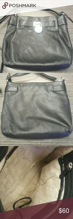 Michael Kors crossbody Black leather Michael Kors preloved crossbody. Silver hardware. Large front snap closure pocket. Main compartment has 4 small pockets, a keyholder and a larger zipper pocket. Slight discoloration inside purse but clean. Leather is in perfect condition, no flaws whatsoever. Last picture shows some loose stitching in strap, but other side is solid leather so there's no concern for breaking - I just like to have everything possible disclosed. Great size bag for all life's…