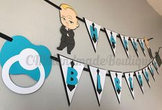 This Boss Baby inspired banner with be the perfect addition to your Boss Baby birthday party. The banner features the Boss Baby himself along with a pacifier, a briefcase and shirt and tie themed pennants. THIS LISTING IS FOR A HAPPY BIRTHDAY BANNER ONLY Pennant Size: 6 Letter