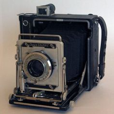 Handheld and large-format, this Crown Graphic film camera was designed for press photographers. Sculptural-looking with its accordion structure and metal details, you'll want to keep this on display to be admired. Suitcase-style box and one film holder come with purchase.