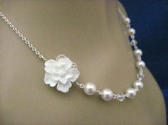 I like this as a bridesmaid gift for the wedding jewelry or maybe for me!  It's a pearl and sakura flower necklace.