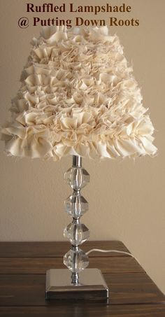 ruffled lampshade -unbleached muslin, cut in strips and ruffled till you can't ruffle any more....hot glue onto old lampshade. Let cool and use (make sure it's to use glue sticks with high melting temp)