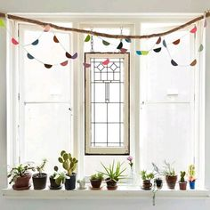 Hey there @little_nicki_ here again! This window is a favorite spot of mine at home. It's got everything you need in a Jungalow - sunshine plants galore something repurposed (a stain glass window I found on the side of the road) and a little touch of handmade ... Find out how to make THIS DIY paper garland on the @thejungalow blog!  Fiona Galbraith by thejungalow