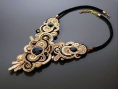 Black, gold, ecru necklace Soutache.