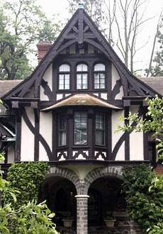 Tudor Revival half-timbering,  particularly in the  gable  ends, employed to emulate the timber-framed cottages of centuries past. Here the gable ends are extended & fitted with elaborate bargeboards made of intricately arranged timbers.