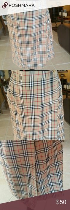 "Burberry wrap skirt, size 4/6 Beautiful vintage wrap skirt in Burberry nova check print. Will fit size 4/6.  This is authentic and has the original Burberry tag that says Burberrys, which is explained below.   Here is the written explanation: "" 'Burberry' was the original name, but then the company soon switched to using the name 'Burberrys', after many customers from around the world began calling it ""Burberrys of London"". This name is still visible on many older Burberry products.""…"