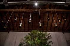 Hanging industrial candles ceremony backdrop | Modern Blue And Yellow Phoenix, Arizona Gay Wedding | Equally Wed - LGBTQ Weddings