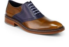 Cole Haan Brown Colton Saddle Oxfords A modern expression of style is reflected in this classic saddle oxford of smooth and grained leather. Leather upper leather lining padded insole leather/rubber sole imported. Color: LIGHT BROWN-BLUE