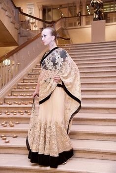 OFF-WHITE/BLACK LEHENGA SAREE Embroidery: Zari and stone work. Fabric: VELVET /Net