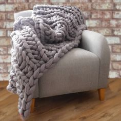 This super chunky hand-knitted decorative throw makes an impact in any room.At the moment only one size is available, it is designed to sit at the end of a double bed.