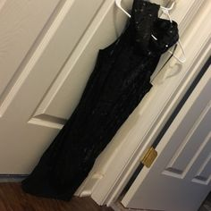 """Black sequin dress Black dress all sequins except  1/2 around arms and the bottom 4"""". In great condition. 😄 the dress is slightly see through, you would want a slip under it, or leggings. bebe Dresses Mini"""