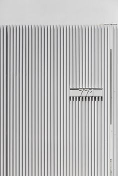 On a long and narrow plot in Portugal sits House in Matosinhos — a white, modern home that stands out from its neighbours. Wedged between two tr. Fence Gate Design, Main Gate Design, House Gate Design, Door Design, Deck Gate, Gate Designs Modern, Branding And Packaging, Fence Doors, Front Fence