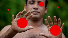 """How many red balls are there in this photo? Did you count 5? Good, but is there anything else you're missing? The man has 12 fingers. It's ok if you missed it. This is called """"inattentional blindness"""", where we can't see what's right in front of us because we're not paying attention to it."""
