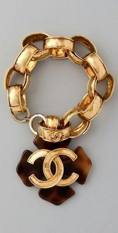 Chanel large ring bracelet.