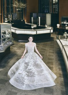BAZAAR Bridal's Breakfast At Tiffany's A preview of Reem Acra's Spring 2018 bridal collection featuring treasures from the Tiffany & Co vault.