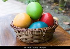BP3HAB Royalty-free Holidays - Easter.  	 Easter celebration: basket with colorful eggs on wood table.