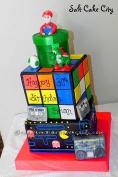 Coolest 80′s Theme Rubik Cube Cake... This website is the Pinterest of birthday cake ideas