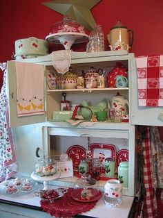 Cute little display of vintage cherry décor...really love. I want to repaint some metal canisters I have and decorate with cherries.