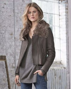 Joanna toscana collared sheepskin biker - Wrap London - With sheepskin fur inside and a statement Toscana shearling collar, this jacket is a statement piece for any wardrobe. Fashionable and fresh, styled with classic biker cues; asymmetric zip closure and two front pockets as well as stitched pattern detailing at the shoulders, its understated and very luxurious. 100% Lambskin.