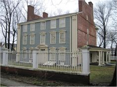Royall House, Medford, Massachusetts, 1737 Side Gabled Georgian Colonial. What started off as a smaller 1600's brick home was expanded in 1737, then given an equally impressive rear facade in 1747. The double chimney stacks on both ends are connected by a parapet, and the sides are left unadorned.