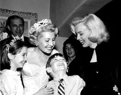 Beautiful shot of Marilyn with Sheila Graham at Sheila Graham's wedding reception on February 14, 1953.