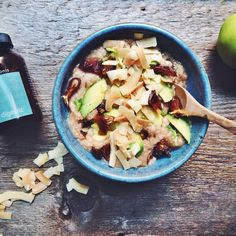 Start your day by nourishing yourself naturally  @purely_elizabeth apple cinnamon oats served with avocado, figs & @dangfoods coconut chips, and a side of #Digestic - I've been taking this magical organic herbal potion hand picked in Israel for 2 weeks and has been making my belly feel so amazing! Check out www.mimonis.com/breakfast-criminals if you're interested! #breakfastcriminals