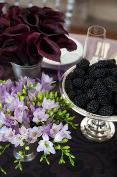 Deep and Rich. Purple freesia, passion calla lilies and a tray of blackberries create a sumptuous display on a patterned eggplant tablecloth. Purple Party, Purple Wedding, Wedding Flowers, Calla Lillies, Calla Lily, Lilies, Flower Centerpieces, Wedding Centerpieces, Centrepieces