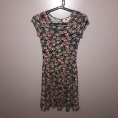 Floral, open-back dress!! Knee length floral dress. Open in the back. Very good condition, no holes or tears. Probably will only fit kids or small teenagers. Sorry for the bad quality picture! TJ Maxx Dresses Midi