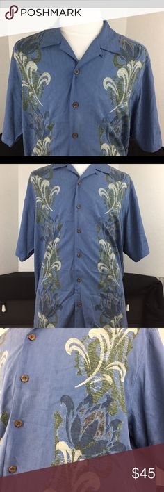 "TOMMY BAHAMA blue Hawaiian textured Silk - LARGE Men's TOMMY BAHAMA blue textured floral design short sleeve 100% silk button front Hawaiian style shirt. Size large. Preowned in very good condition.   Measurements lying flat: Chest: Approx 25"" Shoulders: 22"" Length 30 3/4"" (bottom of collar to bottom of garment) (Smoke Free, Pet Free, Clean Home) Thanks for visiting Tommy Bahama Shirts Casual Button Down Shirts"