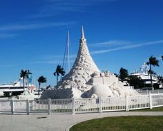 """City of West Palm Beach's """"Holiday Tree"""". If you look closely, you'll see the white material blowing off the right side of the tree. Yes, that is sand.  And in the background are """"Diamonds Are Forever"""" and """"Top Five."""""""