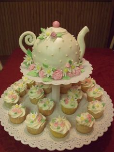 "I try to have a ""show stopper"" dessert at each tea I host. For my very first tea I made a teapot cake like this. It's really super easy with the cake pans they have today on the market."