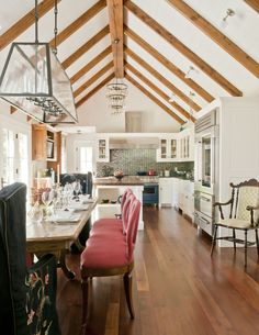 Love this look but I would prefer it with windows with black frames and black metal supports for the beams - Love the light fixture!!!