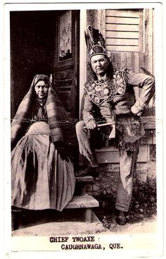 IROQUOIS Mohawk Chief Two-Axe  & his wife Konwakeri Kentiokokta, Caughnawaga (Kahnawaké) reservation, Québec, Canada, c.1910. Dominic Two-Axe became Chief of the Turtle Clan from Kahnawake about 1923. The couple had a girl, Mary Two-Axe Earley (1911-1996), who were an active militant for Native Women Rights. Real Photo Postcard edited c.1930-1950.