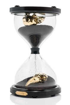 Concept  The contemplation of finite time, life, death, and beauty.  Each piece resembles a traditional hourglass, but at the bottom of each glass compartment a gold plated animal skull is mounted.   The hourglasses of varying sizes are...