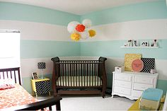 love the striped two tone walls - and the large stripes makes the room seem so big along with horizontal direction