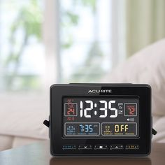AcuRite Atomic Dual Alarm Clock with USB Charging 13024  Features:  Illuminated color display with indoor temperature.  Atomic clock, date, day of week, and two alarms.   USB charging for compatible smartphones.   Dual, programmable alarms can be set for everyday use, weekdays or weekends only.  $39.99 at AcuRite.com