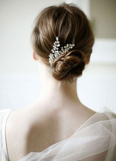 11 Effortlessly Romantic Wedding Hairstyles: A quickly tied bun is so chic with an open back dress and crystal clip. Belathee Photography