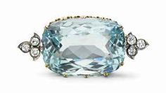 A gold, silver, aquamarine and diamond brooch