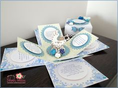 Baby Boy Exploding Box Card with pram and blue flowers at centre.