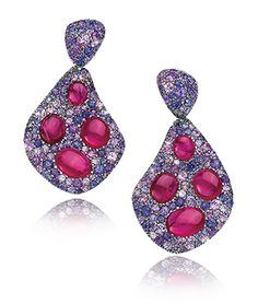 Cabochon Gemstone Earrings  Cabochon Ruby gemstones are set in a pave of purple sapphires; Set in 18k Rose Gold.   Ruby total carat weight 7.60ct, Purple Sapphires total carat weight 5.38ct.