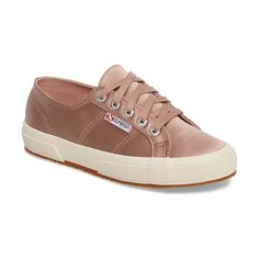 satin sneaker by Superga. Clean-lined and classic, this rubber-soled sneaker from Superga is updated with lustrous satin for a luxurious finish.