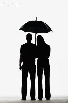 Couple Sharing An Umbrella