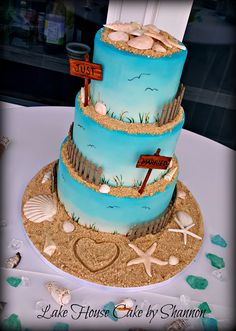 Beach themed, beach sand, sea shells, sea shells, wedding cake turquoise, sky blue, blue, star fish, starfish, fingerling starfish, pencil starfish, Lake House Cake by Shannon Panama City Beach Florida