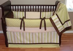 Green Tea Baby Bedding  This custom bedding set includes the bumper, blanket and tailored crib skirt. The stripe and polka dot bumper features multiple shade of green and ultra soft chocolate and ecru minky. The blanket is chocolate minky backed with a soft cuddle edge and the front has both polka dots and stripe with chocolate trim.