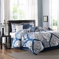 The Madison Park Vienna Comforter Set mixes a classic design with a contemporary pattern to give you this unique collection. This updated leaf design is featured inside of an oversized ogee for an eye catching top of bed. Made from 200 thread count cotton sateen on the face, this comforter and shams are soft to the touch and have a 180 thread count cotton/poly reverse. Three decorative pillows feature tufting and embroidery details for added value to complete this collection.