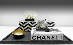 Your coffee table is an ideal place to showcase beautiful trays, books, boxes and decorative objects.