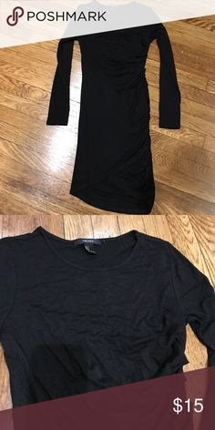 Forever 21 BLACK bodycon dress Black, 98% rayon. Side ruched, hits above knee. Tight fitted and long sleeves, crew neck dress. Super soft and comfortable. Never worn! Fit is like red dress in last photo but dress being sold here is black! Forever 21 Dresses Mini