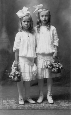 FLOWER GIRLS: Two little ladies pose for wedding picture album. June, 1914.
