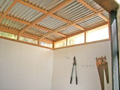 step 5: corrugated metal roof, clerestory windows & peg-board interior walls.  A pegboard inside provides infinite organization options for tools that need protection from the elements.  The shed has a pleasant and open feel for 80 square feet.